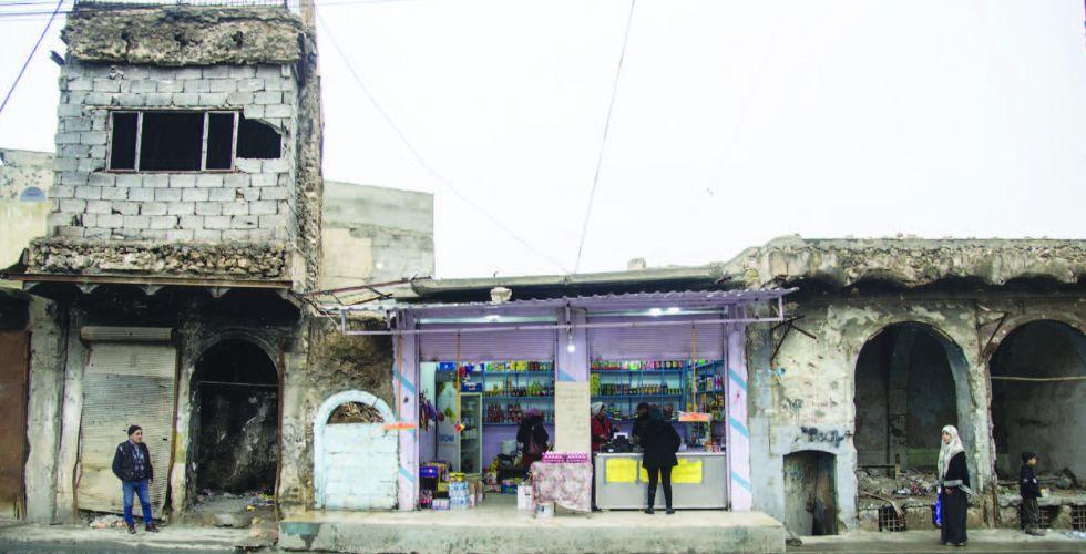 توزيع التعويضات بين مئات المتضررين في الموصل