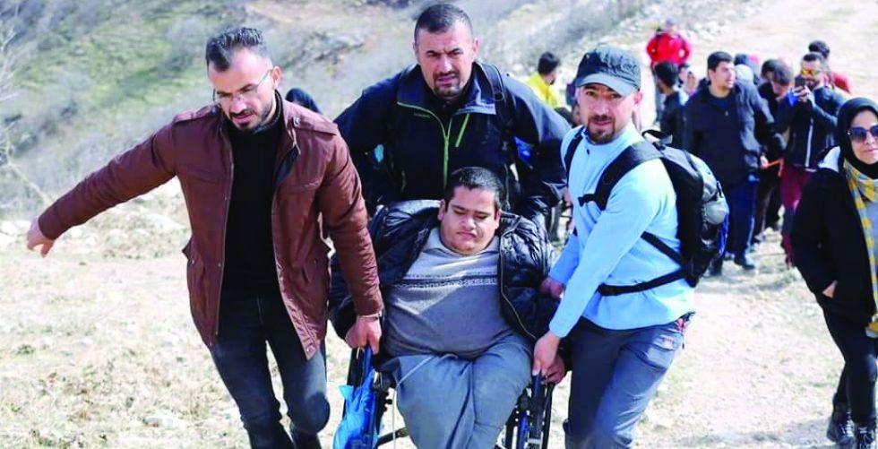لأول مرة في العراق..ذوو الاحتياجات الخاصة يتسلقون جبال كردستان