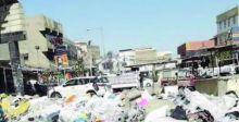 اعتصام عمال النظافة يتسبب بانتشار النفايات في شوارع الكوت