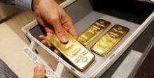 الذهب يهبط مع صعود الأسهم